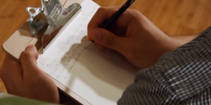 image of someone writing a letter